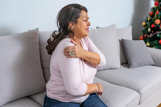 Senior woman with shoulder pain
