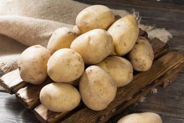 Raw potato. Rustic style