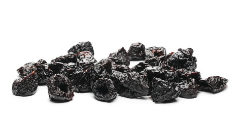 Dry prunes pile isolated on white