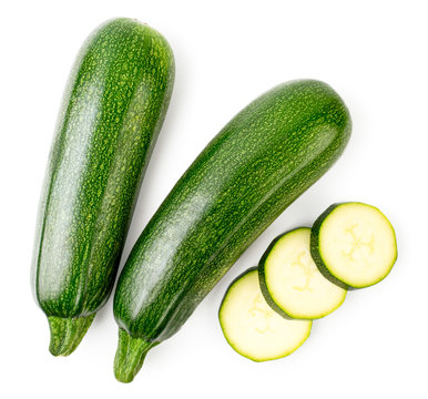 Ripe zucchini and sliced slices on a white. The form of the top.