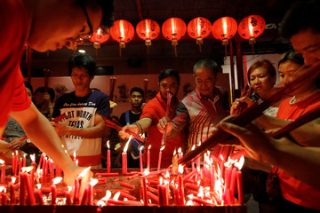 Ethnic Chinese Indonesians light incense sticks during Lunar New Year's eve at Dharma Bhakti temple in Jakarta