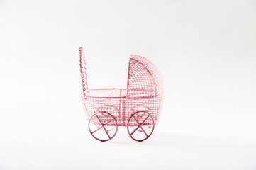 A miniature stroller for a child isolated on a white background. Two strollers for a boy and a girl on a white background. The concept of twins pink and blue, in vitro fertilization