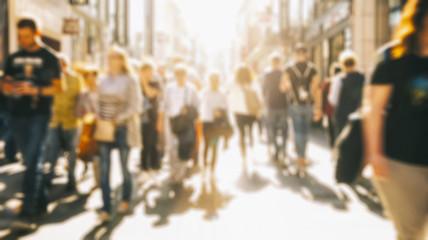 Fototapete - anonymous crowd of people walking