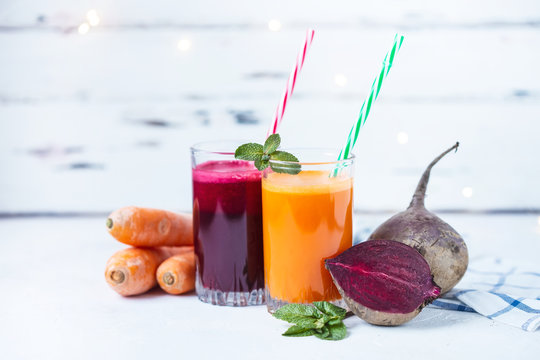 fresh juice from homemade vegetables. Beet and carrot smoothie. Detox, vegetarianism On a bright summer background
