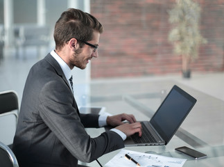 businessman typing text on laptop.