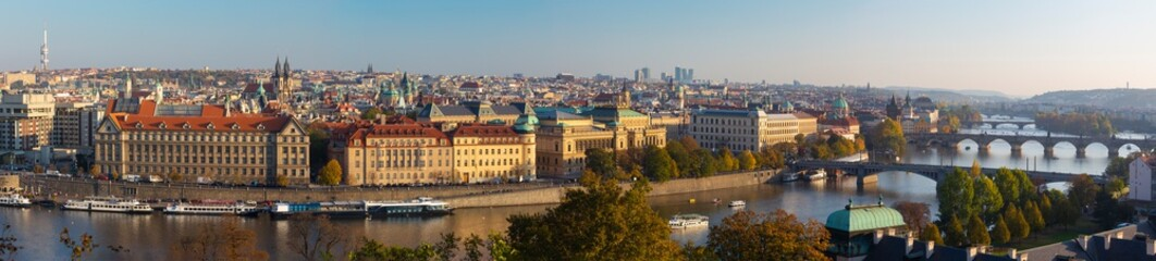 Prague - The panorama of the city with the bridges in evening light.
