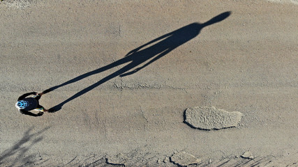 A shadow on the road.