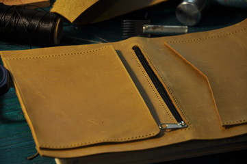 leather workshop Yellow leather and tools on the table