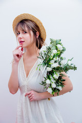 Beautiful woman with white roses wreath on white background. Springtime concept or Valentines Day holiday