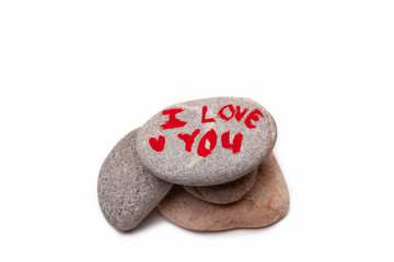 A pile of stones with I LOVE YOU painted on the top one