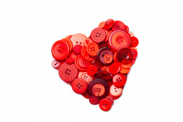 Heart made of red buttons isolated on white