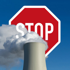 cooling tower of a coal power plant - stop sign - concept image fossil fuel exit