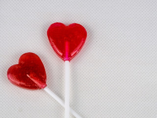 Two heart-shaped lollypops.