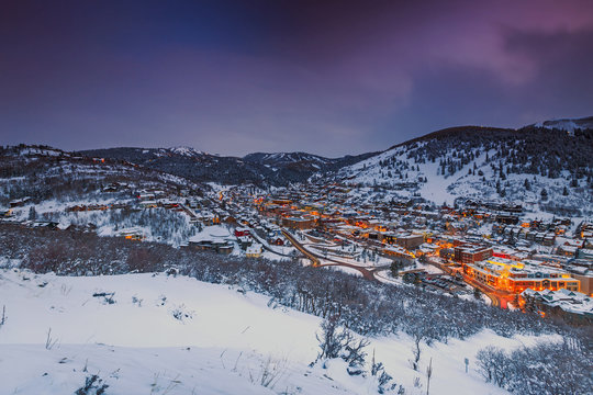 Winter night in Park City, Utah, USA with city lights.