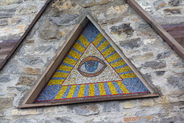 All-seeing eye of God - a mosaic of wall background medieval church. Eye of Providence