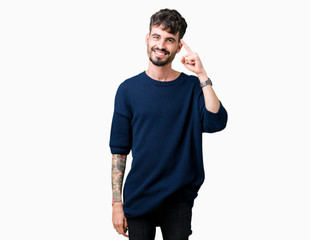 Young handsome man over isolated background Smiling pointing to head with one finger, great idea or thought, good memory