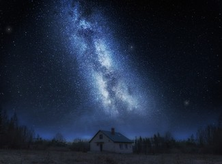House under night sky with stars
