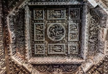 Halebidu, Karnataka, India - November 2, 2013: Hoysaleswara Temple of Shiva. Extensively decorated square mandala in octogenal mandala on ceiling in Mandapam.