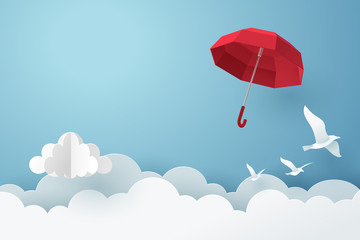 Paper art of red umbrella fly above the cloud on the sky