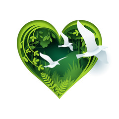 Paper carve to bird fly out from green forest heart shape, paper art concept and ecology idea