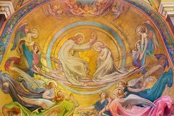 PRAGUE, CZECH REPUBLIC - OCTOBER 13, 2018: The Coronation of Virgin Mary fresco in the side apse of church kostel Svatého Václava by Rudolf Max Pirner (1885). Wall mural