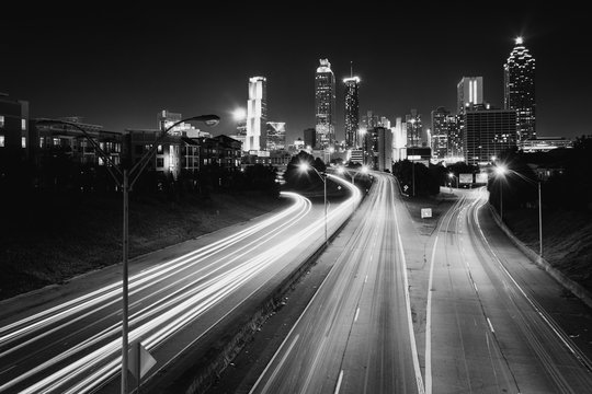 Traffic on Freedom Parkway and the Atlanta skyline at night, seen from the Jackson Street Bridge in Atlanta, Georgia.