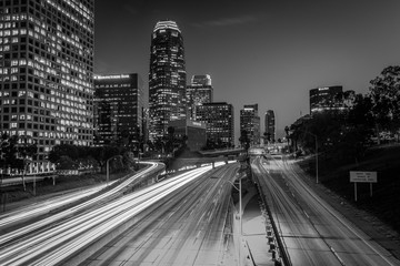 Traffic on the 110 Freeway and the Los Angeles Skyline at night, seen from the 4th Street Bridge, in downtown Los Angeles, California. Wall mural