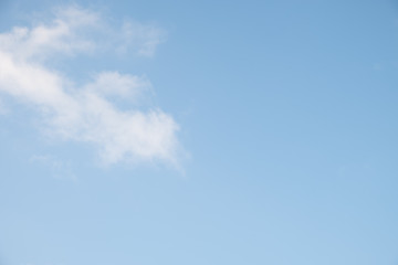 Blue sky with tiny clouds background,
