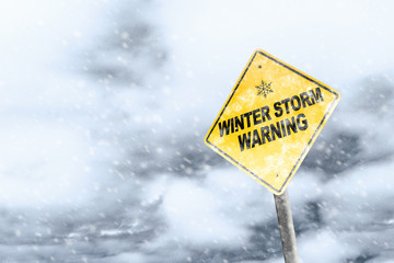 Winter Storm Warning Sign With Snowfall and Stormy Background Fotobehang
