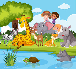 Animals and people near pond