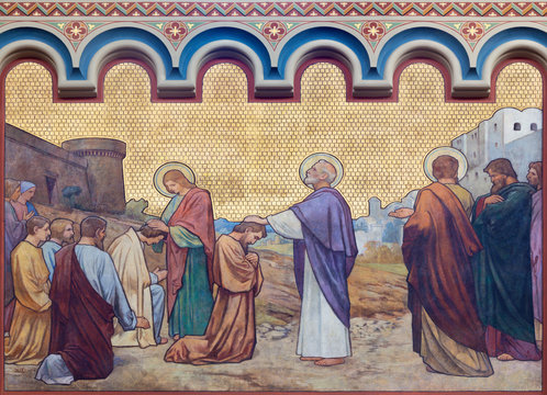 PRAGUE, CZECH REPUBLIC - OCTOBER 17, 2018: The fresco Apostles Peter and John heal in Jerusalem in the church kostel Svatého Cyrila Metodeje by  S. G. Rudl (1896).