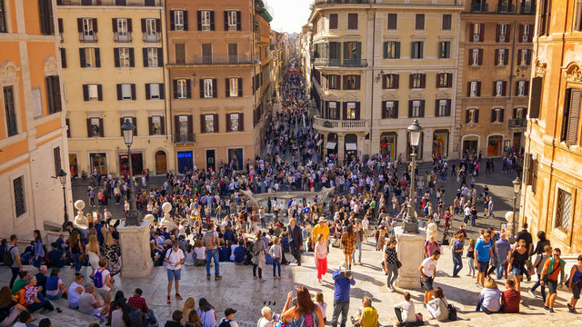 Tourists sit on the Spanish Steps at Piazza di Spagna in Rome, Italy