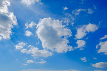 Fluffy cloud above beautiful blue sky background