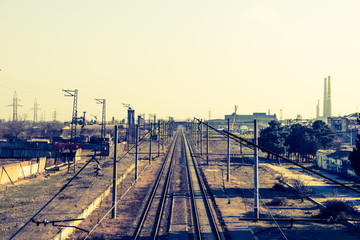Railway lines. Road to infinity. Rails going far to horizon. Old railroad in an industrial town.
