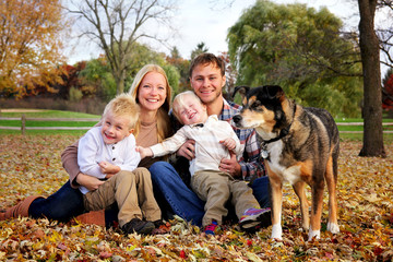 Portrait of a Happy Family of Mother Father and Two Kids and Their Dog on an Autumn Day