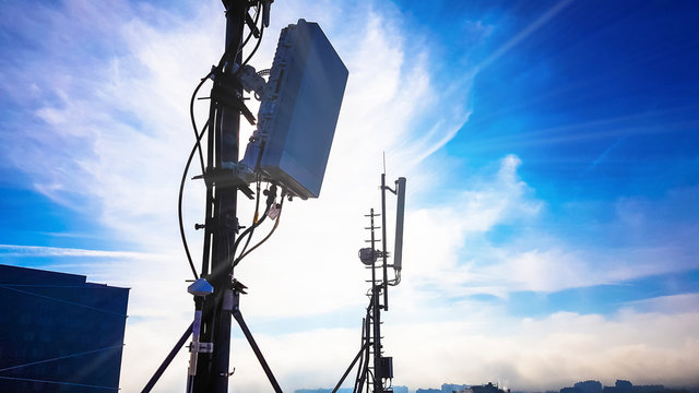 Silhouette of 5G smart cellular network antenna base station on the telecommunication mast