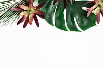 Summer composition. Tropical flowers and leaves on white background. Summer concept. Flat lay, top view, copy space