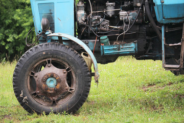 Old tractor wheel and engine