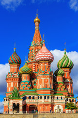 Architecture of St. Basil's Cathedral in Moscow against blue sky with clouds in sunny day