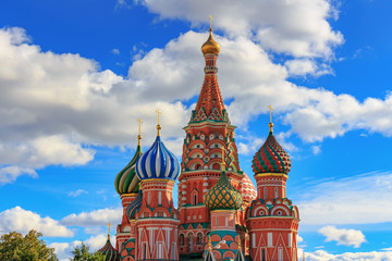 St. Basil's Cathedral onions on a background of blue sky with white clouds