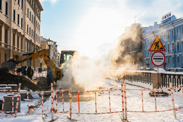 St. Petersburg, Russia - January 28, 2019: Accident on the heating line under the ground - thick steam from under the sewer manhole