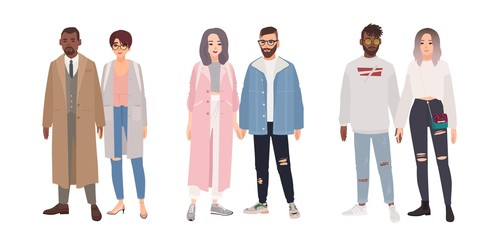 Bundle of cute stylish couples or romantic partners isolated on white background. Set of men and women dressed in trendy clothes standing together and holding hands. Flat cartoon vector illustration.