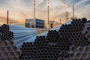 Metallurgy industry concept. Many steel pipes stacked. 3D rendered illustration