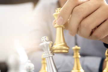 business man with chess board game, strategy and competition.
