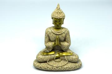 Buddha figure meditating on a white background