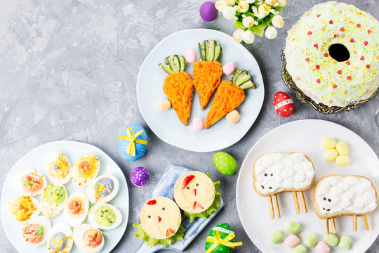 Funny colorful Easter food for kids with decorations on table. Easter dinner concept