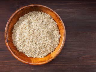 Rice in bowls on a brown background