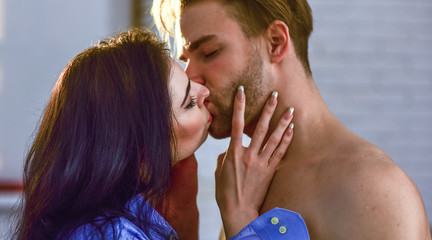 Sensual kiss of lovely couple close up. Passionate kiss concept. Couple in love kissing with passion. Man and woman attractive lovers romantic kiss. Seduction and foreplay. Celebrate valentines day