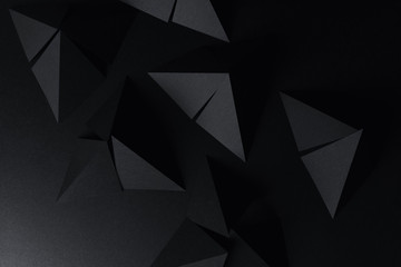 Pyramidal shapes of black paper, abstract background