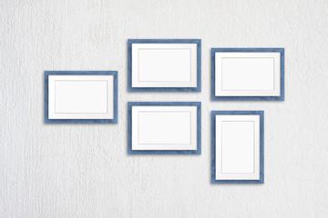 Frames collage, five grey blue realistic wooden frameworks on white plastered background